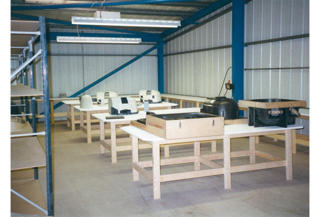 Workspaces being equipped for moulding production.